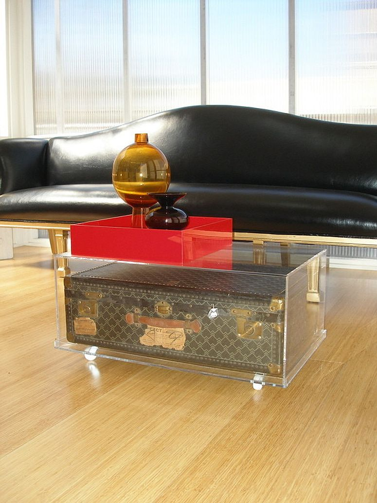 Vintage trunk encased in a cool acrylic box to create a stunningly unique coffee table