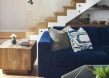 Wooden-staircase-creates-a-stylish-and-striking-backdrop-for-the-living-room-217x155
