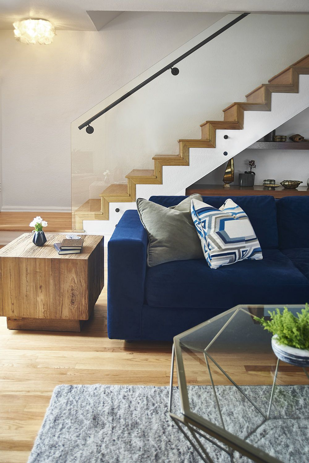 Wooden staircase creates a stylish and striking backdrop for the living room