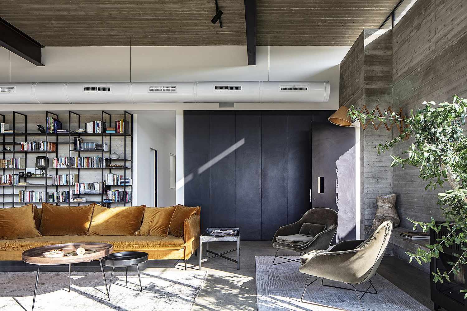 Wooden walls and metallic bookshelf inside the living room