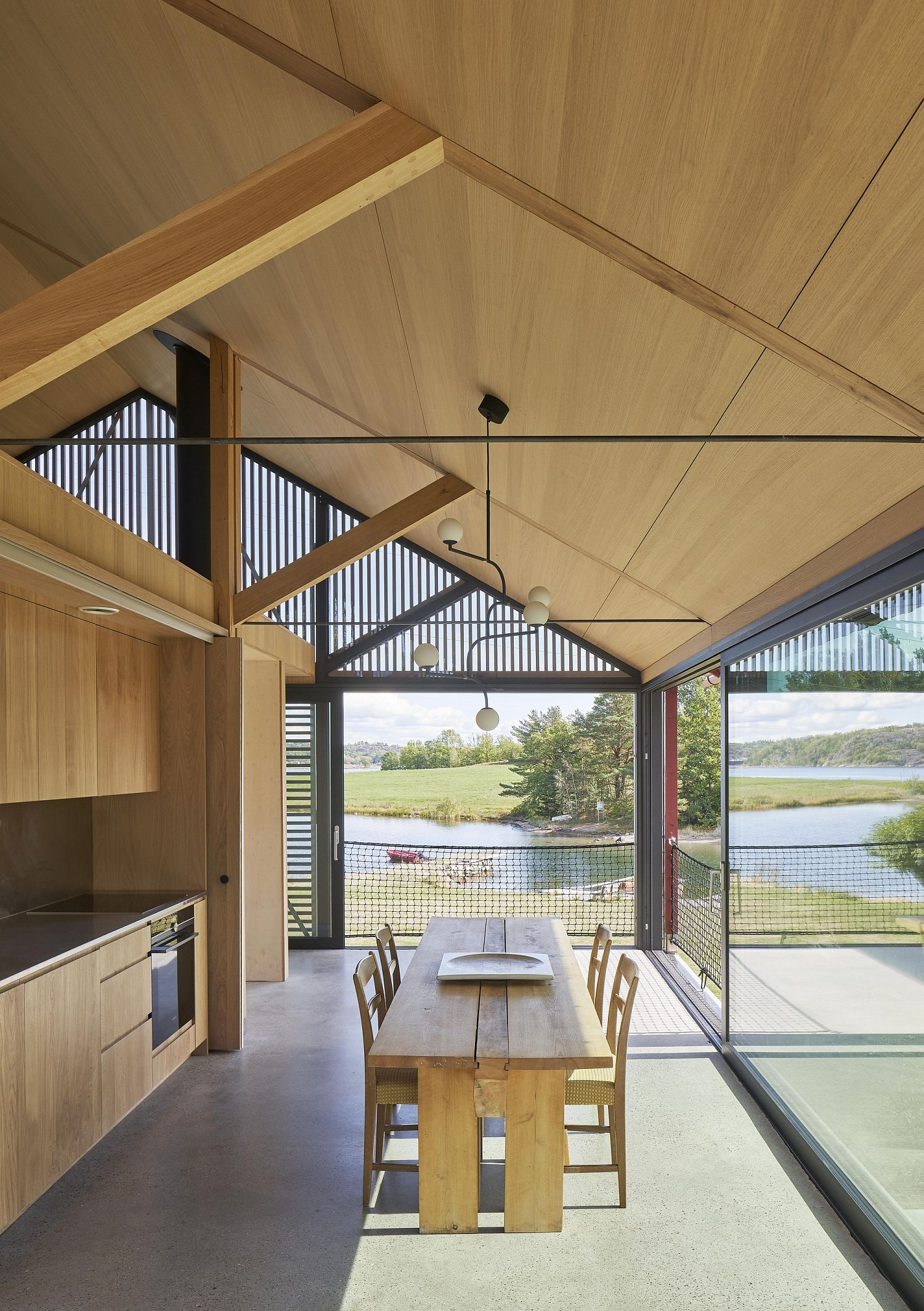 Woodsy kitchen and dining that overlooks the scenery outside