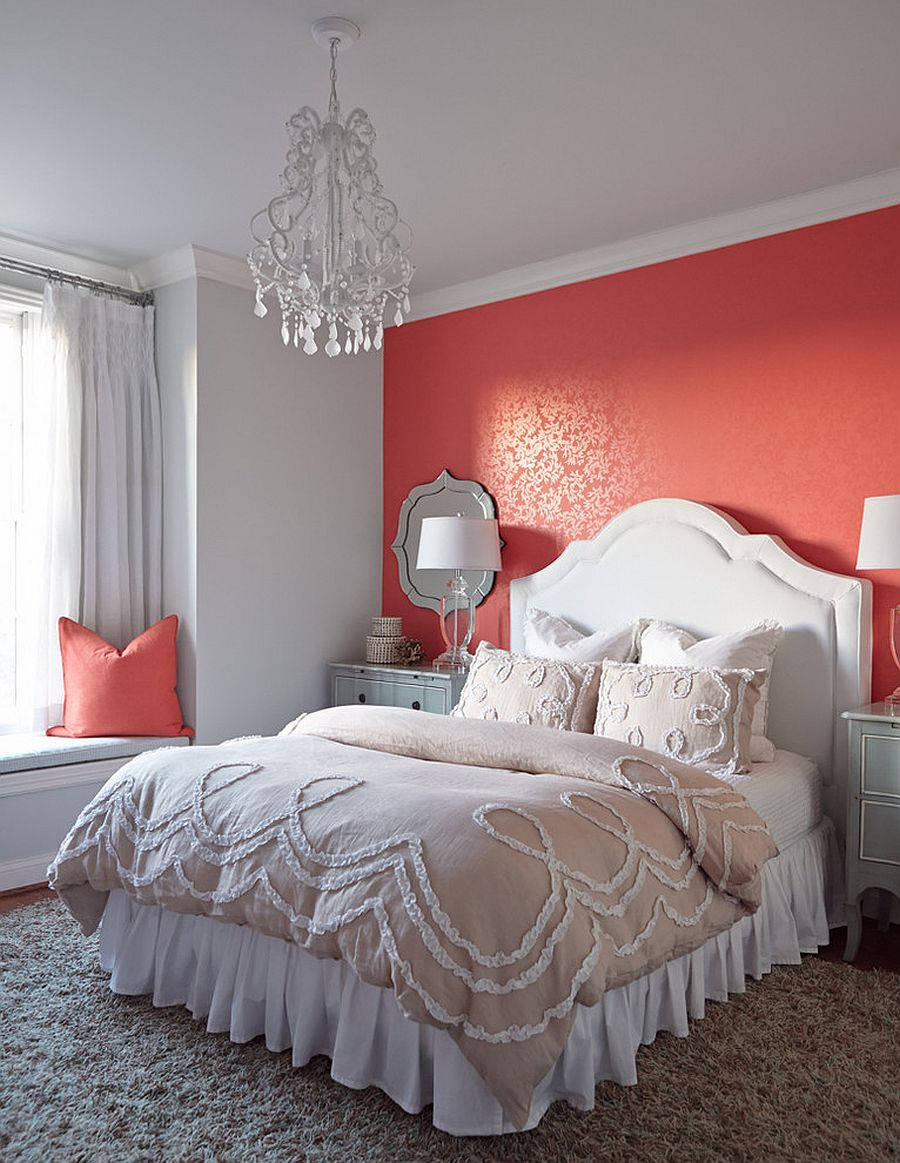 Accet wall in the bedroom in bright coral with subtle pattern