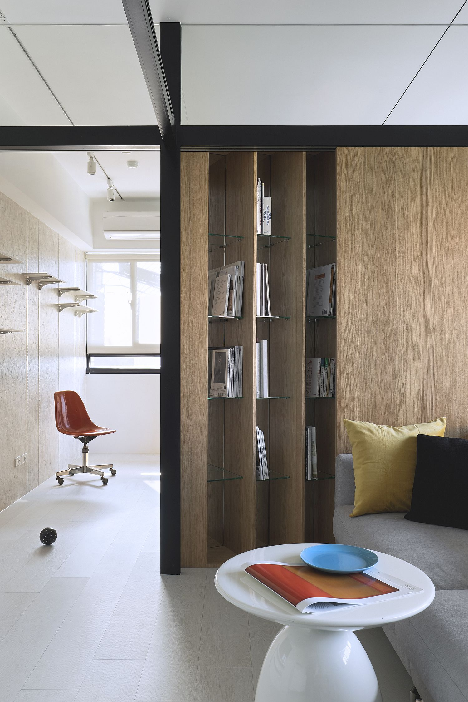 Angled bookshelf design brings something unique to the bedroom