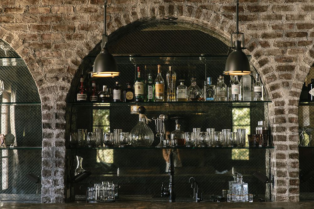 Arches and brick walls give the home bar a touch of authencity
