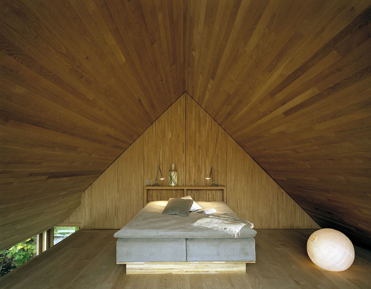Attic bedroom feels serene and magical as it takes you into a minimal world