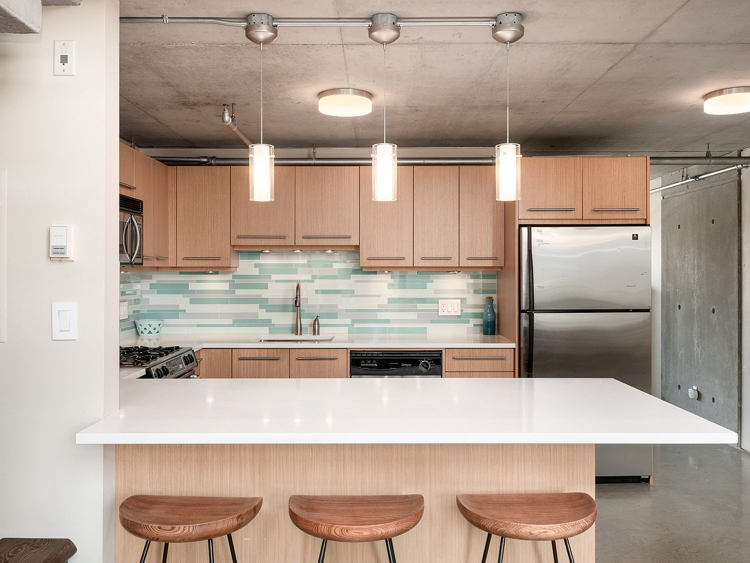 Backsplash adds color to the kitchen in an understated fashion