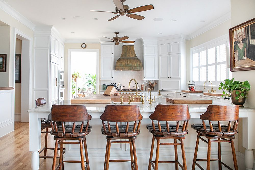 Bar stools add woodsy element to the kitchen in white