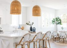 Beach-style-kitchen-in-white-with-organic-finishes-and-wonderful-use-of-rattan-pendant-lights-217x155