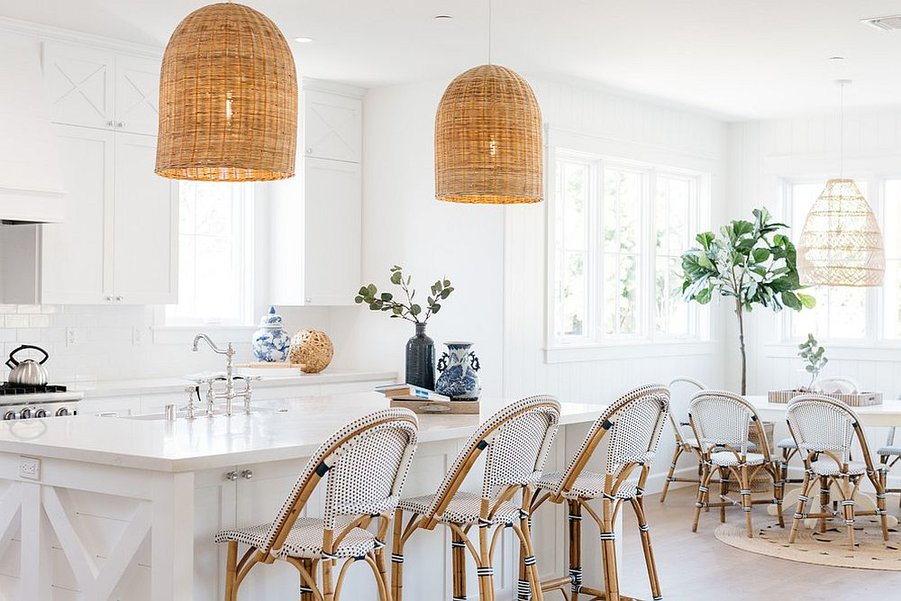 Beach style kitchen in white with organic finishes and wonderful use of rattan pendant lights