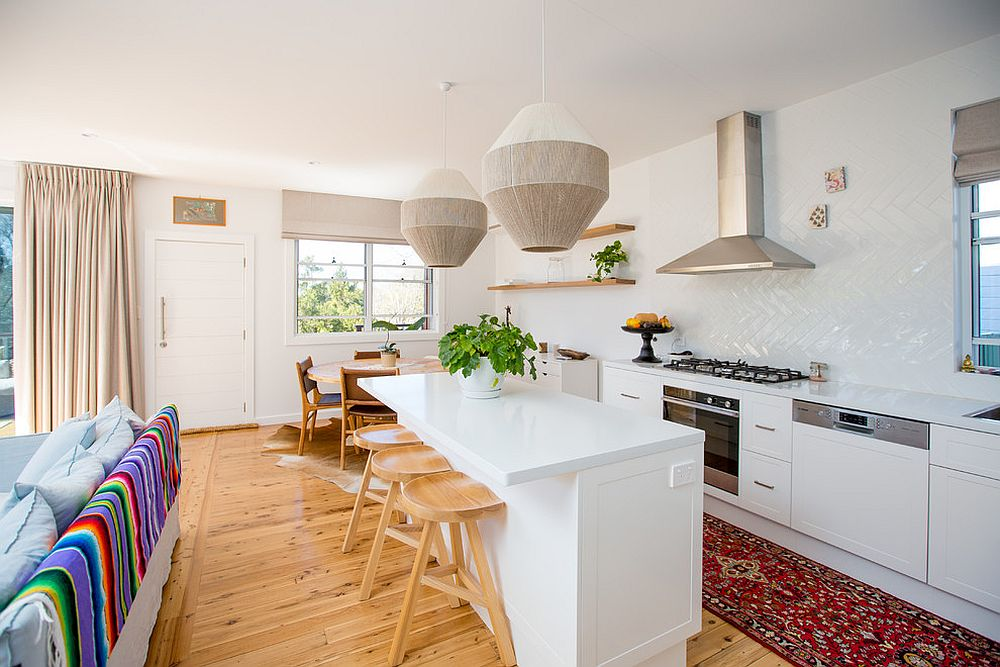 Beach-style-kitchen-in-wood-and-white-with-a-rug-that-adds-a-dash-of-red
