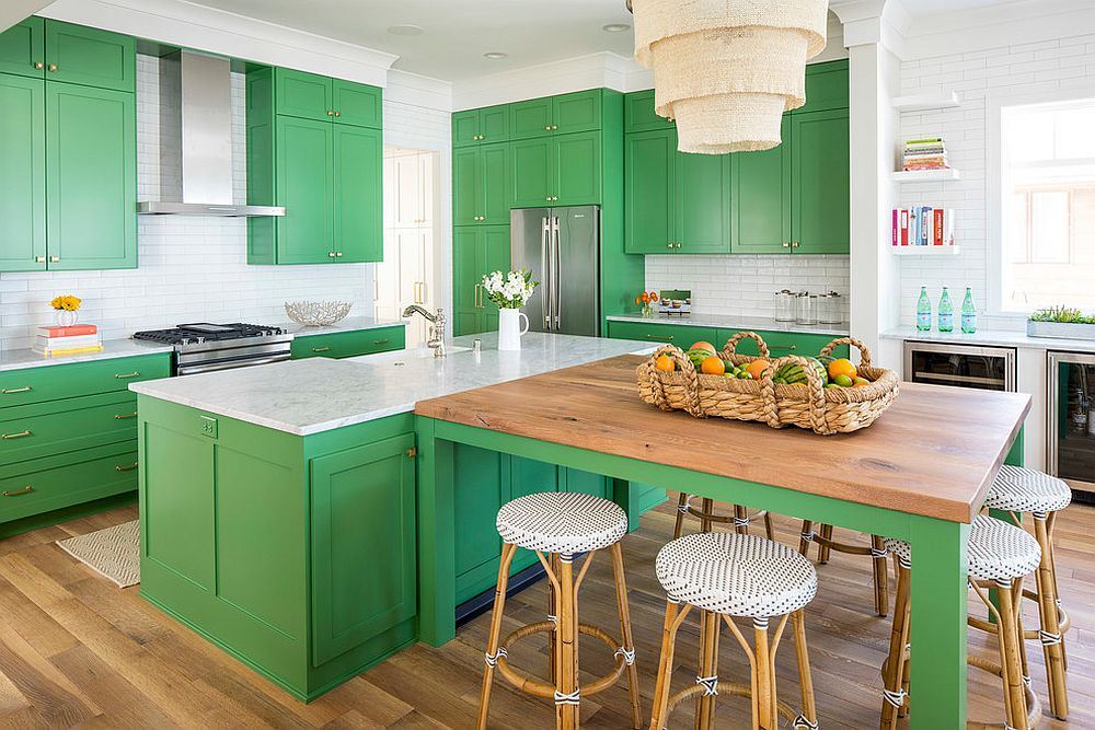 Beach style kitchen in white with green cabinets and island and smart countertops