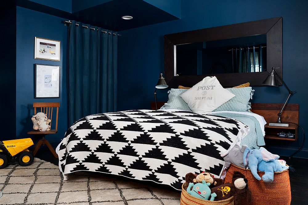 Bedding and decor add black to this blue kids' bedroom