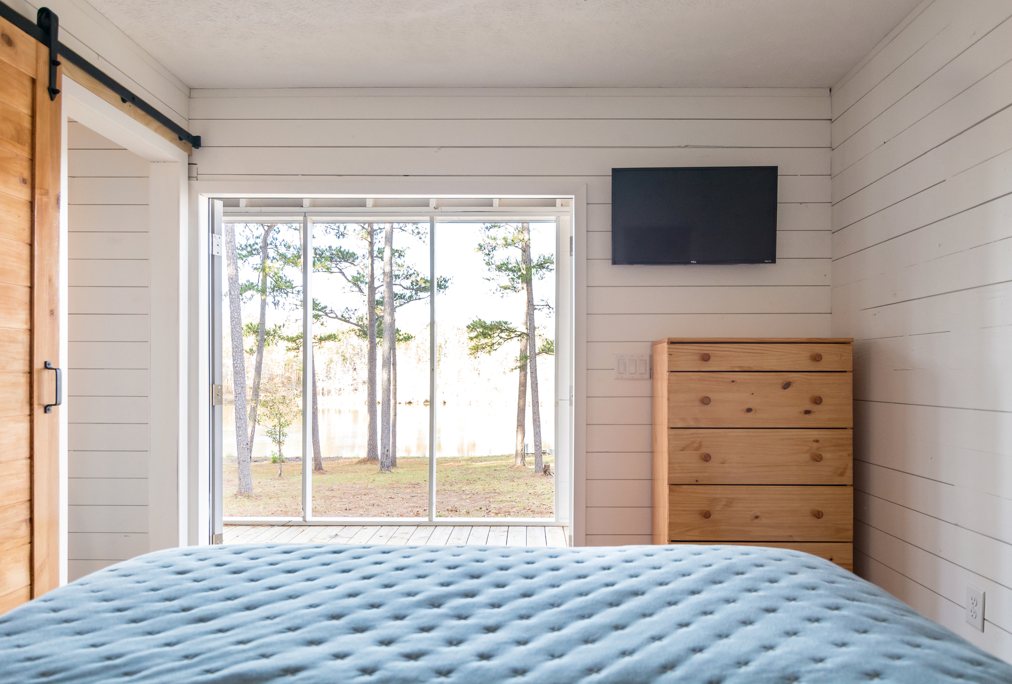 Bedroom of the tiny house with a wonderful view of the woods