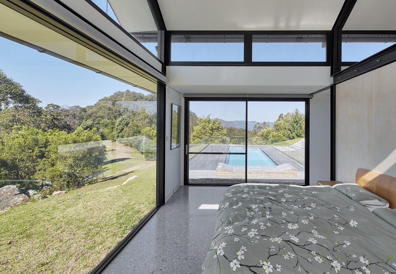 Bedroom with a sweeping view of the pool area and the valleys beyond