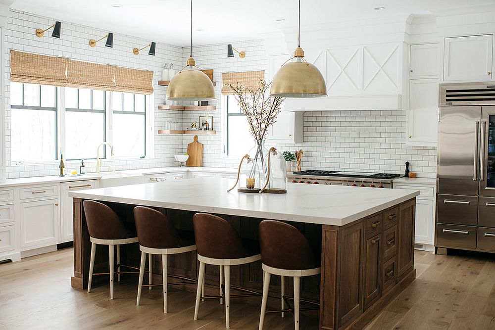 Bold pendants add metallic brilliance to the kitchen in white and wood