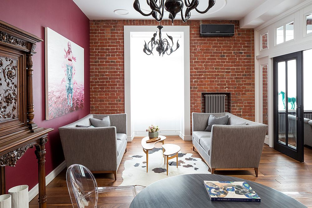 Brick and pink find space next to each other in this eclectic living room
