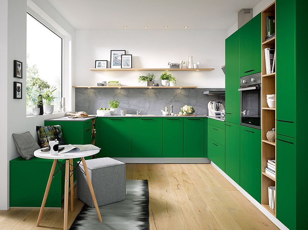 Bright green kitchen cabinets and decor instantly uplift the vibe of this modern kitchen