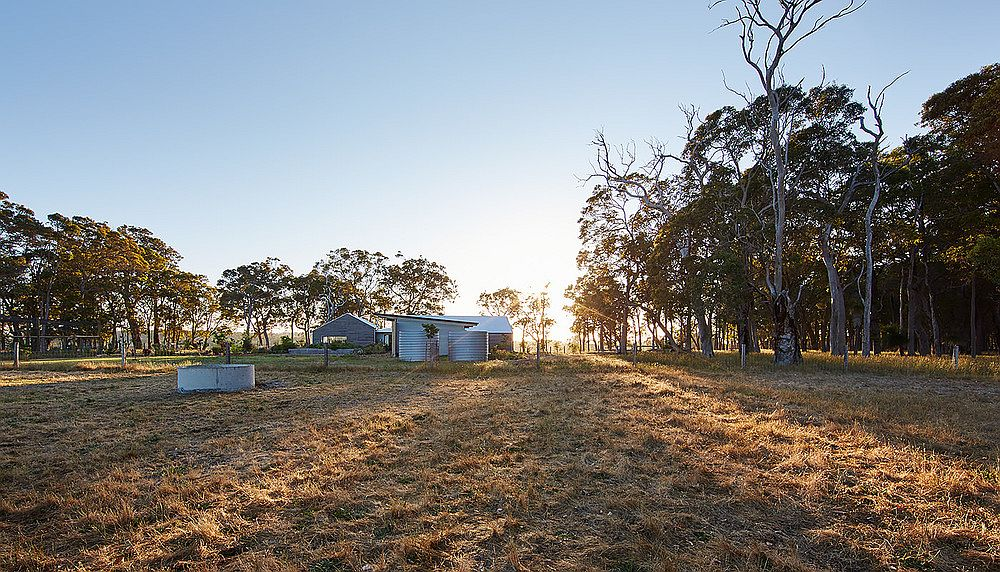 Bushland landscape around the farm house adds to its charming traditional appeal