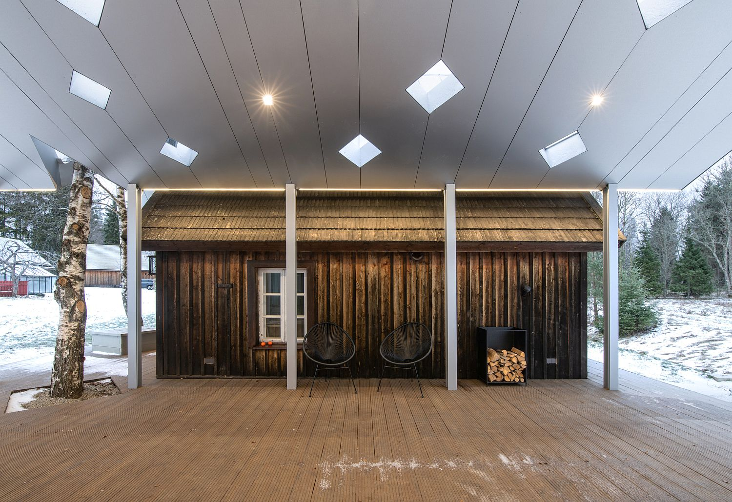 Central atrium offers a spacious sitting zone between the two saunas