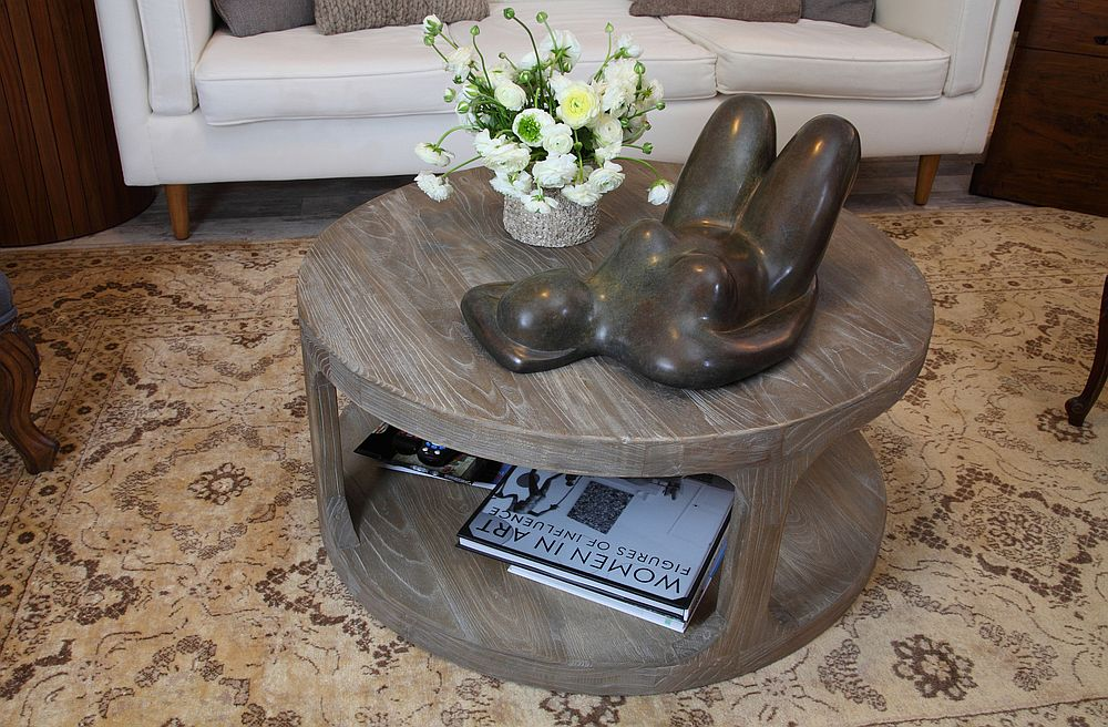 Coffee table in the sitting room with custom sculpture