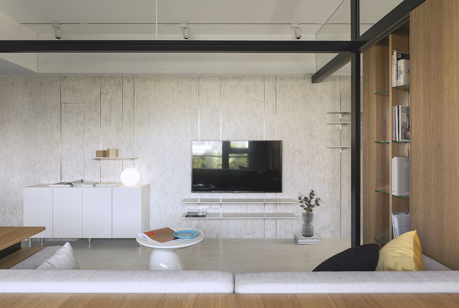 Concrete wall for the living room gives it a smart and sturdy backdrop