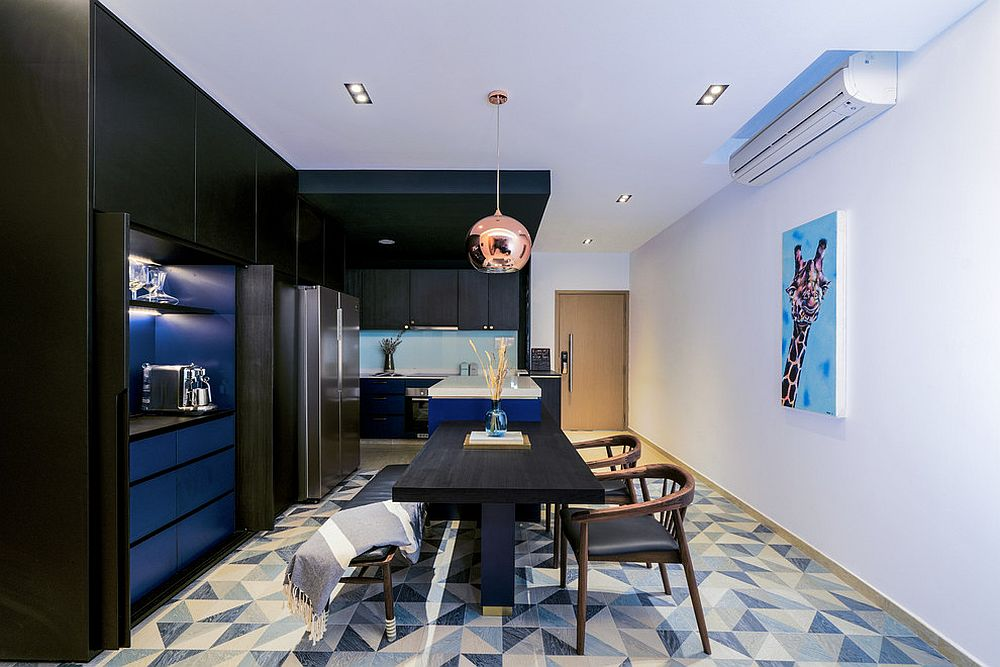 Contemporary kitchen and dining room in blue and black with a white backdrop