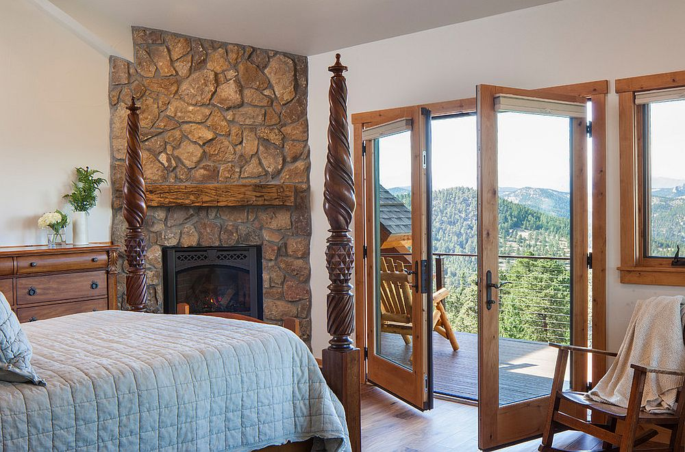 Corner fireplace in the rustic bedroom with stone finish