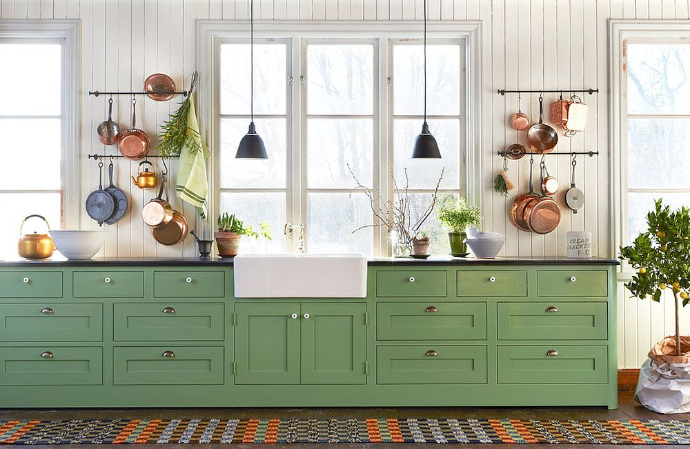 Create a wonderful display with pots and pans in the farmhouse kitchen