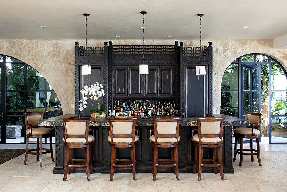 Custom cabinetry for the casual and inviting Mediteranean home bar