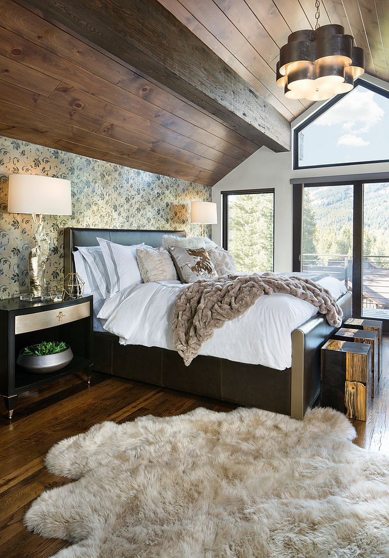Design of the ceiling and extensive use of wood brings rustic vibe to this modern bedroom