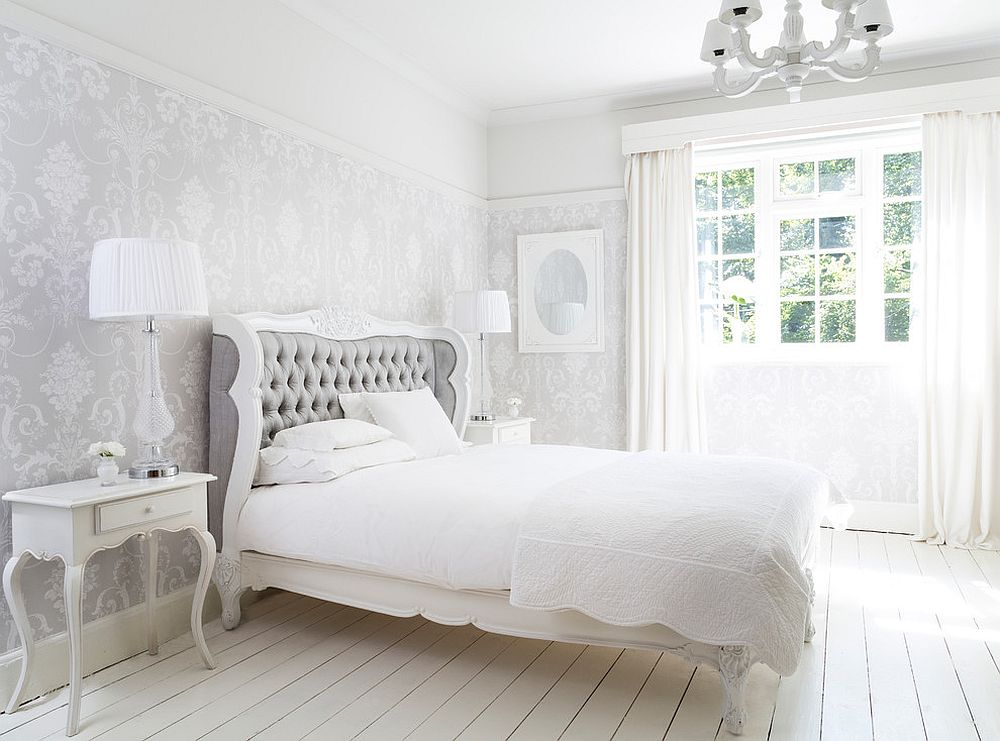 Exclusive shabby chic bedroom in white with walls that exude understated class