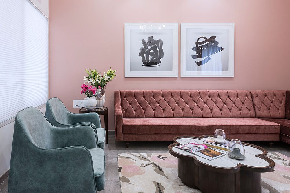 Exquisite modern living room in pik that features sectional in matching pink hue