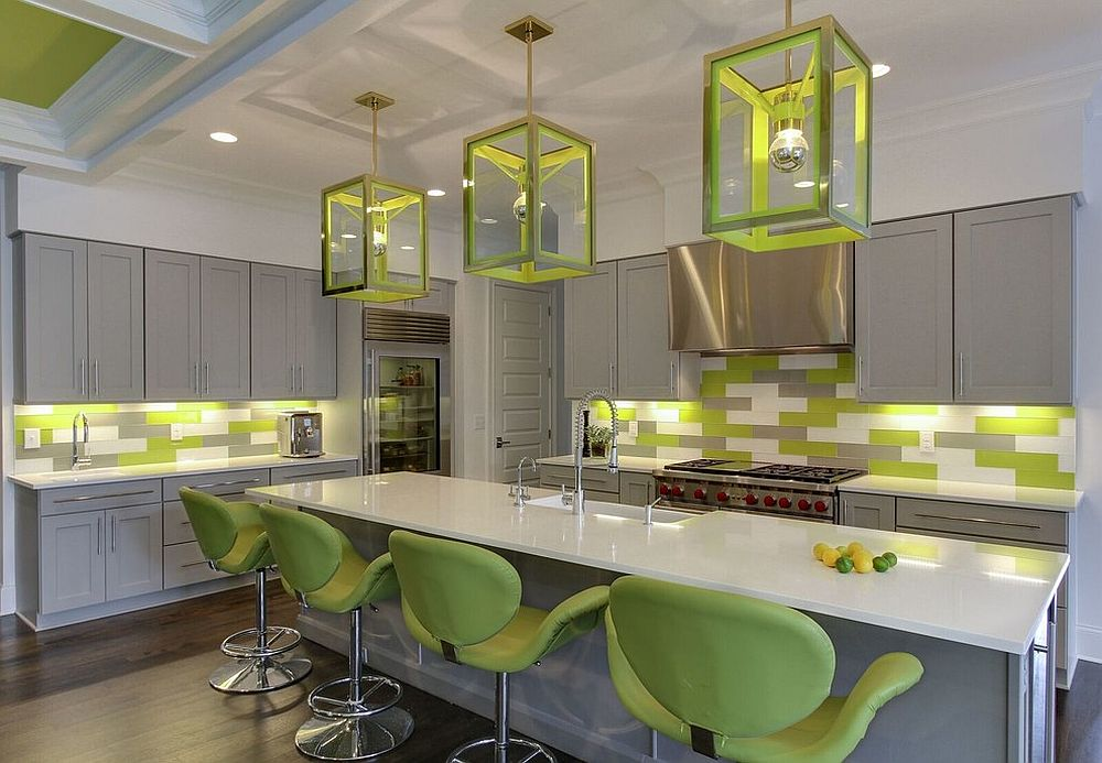 Fun way of adding green to the kitchen with bar chairs, backsplash and cool lighting fixtures