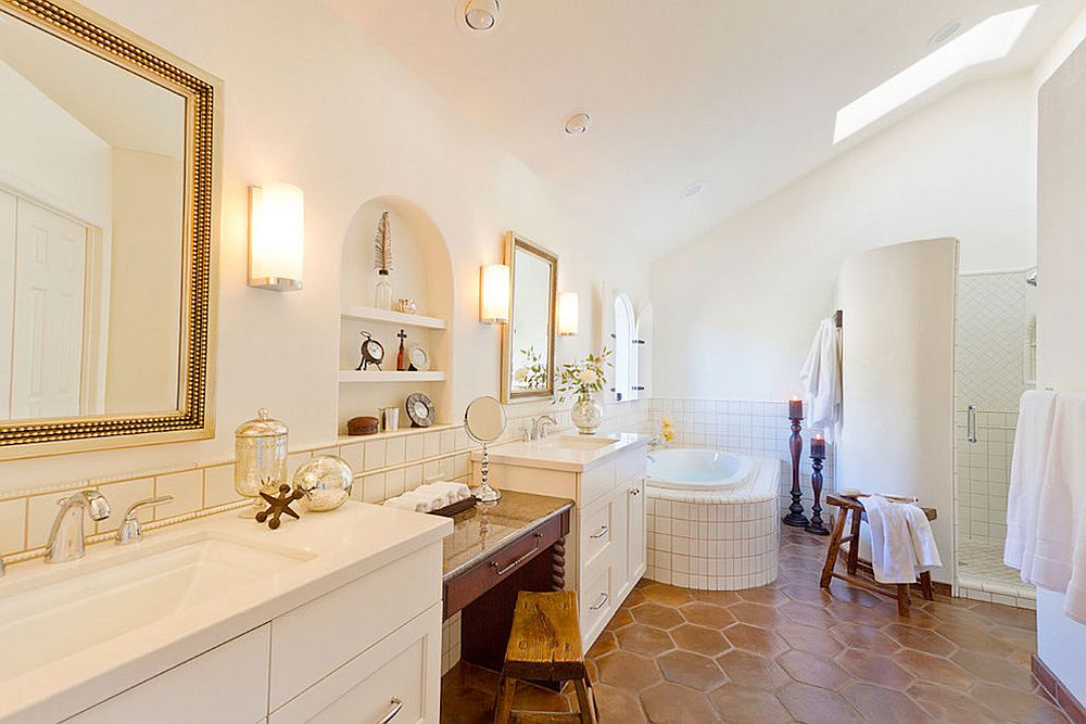 Golden accents add brightness to bathroom in white with skylights and terracotta tiles