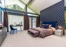 Gorgeous-modern-bedroom-with-purple-headboard-wall-drapes-and-brilliant-pops-of-blue-all-around-217x155