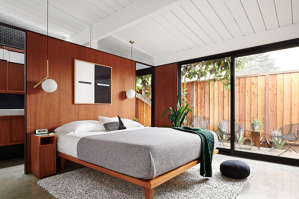 Greenery outside adds freshness to this bedroom in white and wood