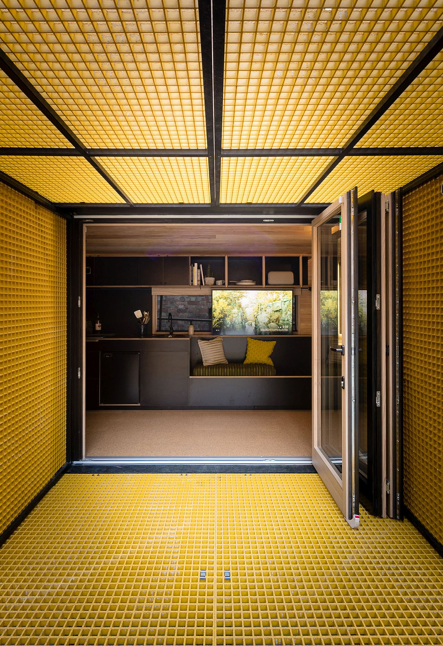 Gridded yellow panels create unique sun shades which can be lowered using automated hydraulics