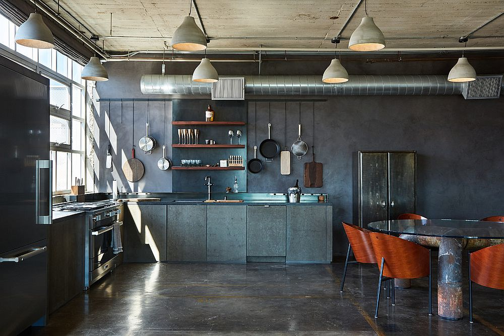 Industrial style kitchen with a display of pots and pans