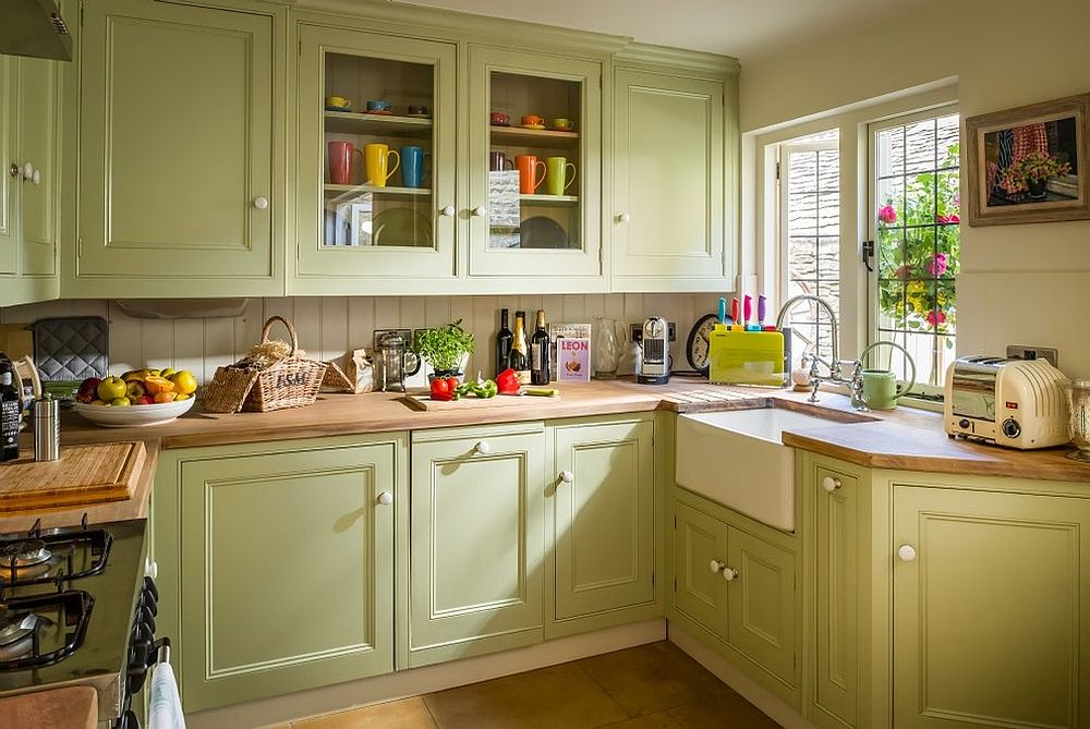 Kitchen brings natural light into the small farmhouse kitchen in pastel green