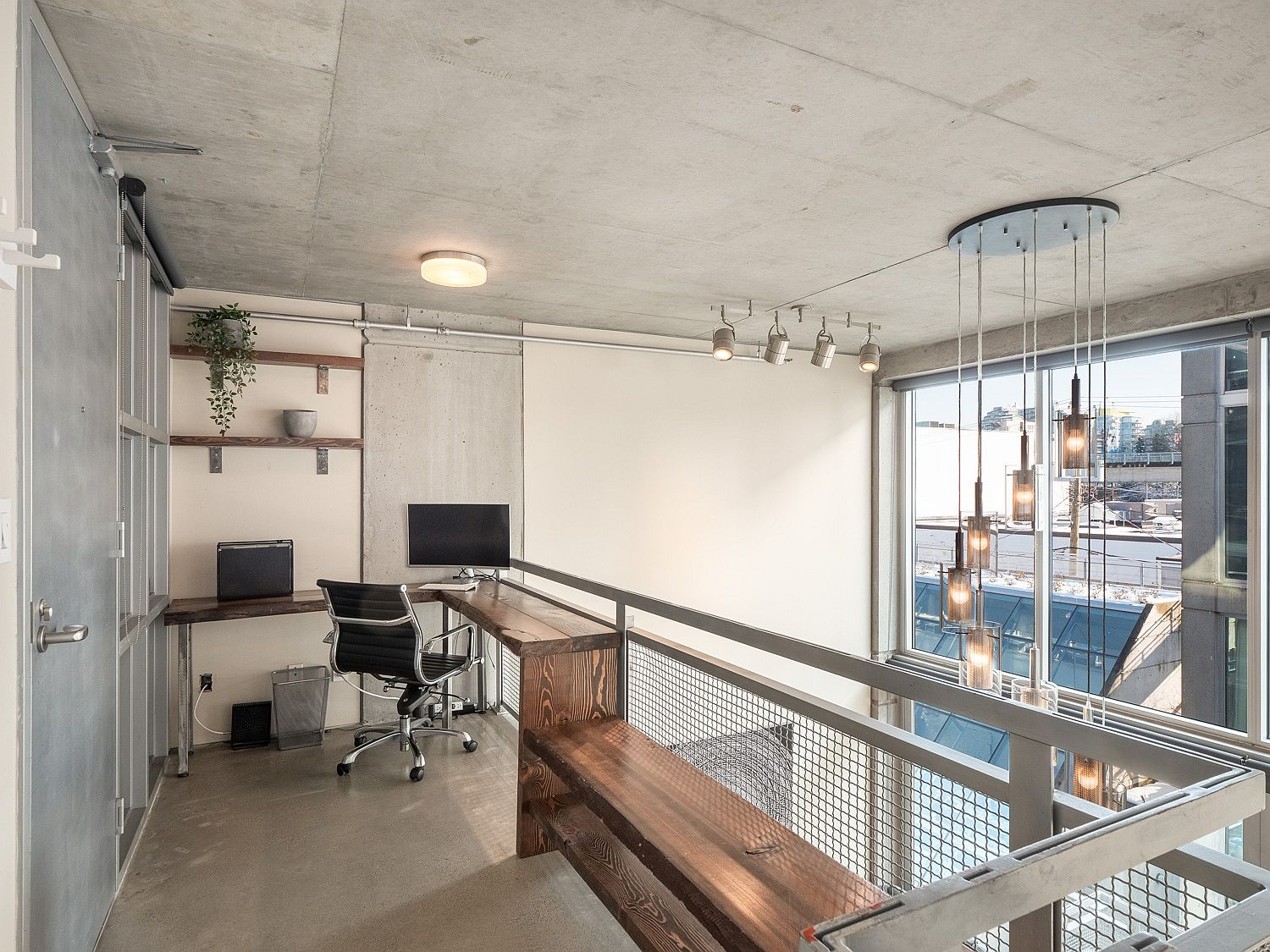 Loft level of the apartment with a view of the living area and beyond