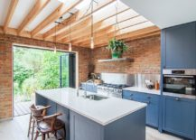 Lovely-beach-style-kitchen-with-brick-walls-and-wooden-ceiling-beams-217x155