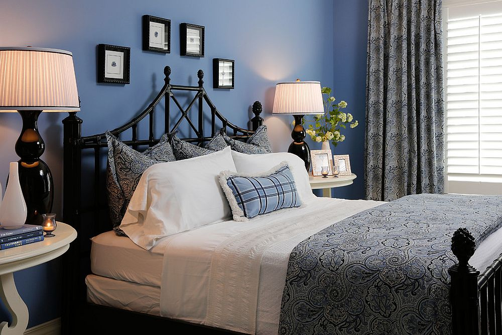 Lovely traditional bedroom in black and blue with ample natural light