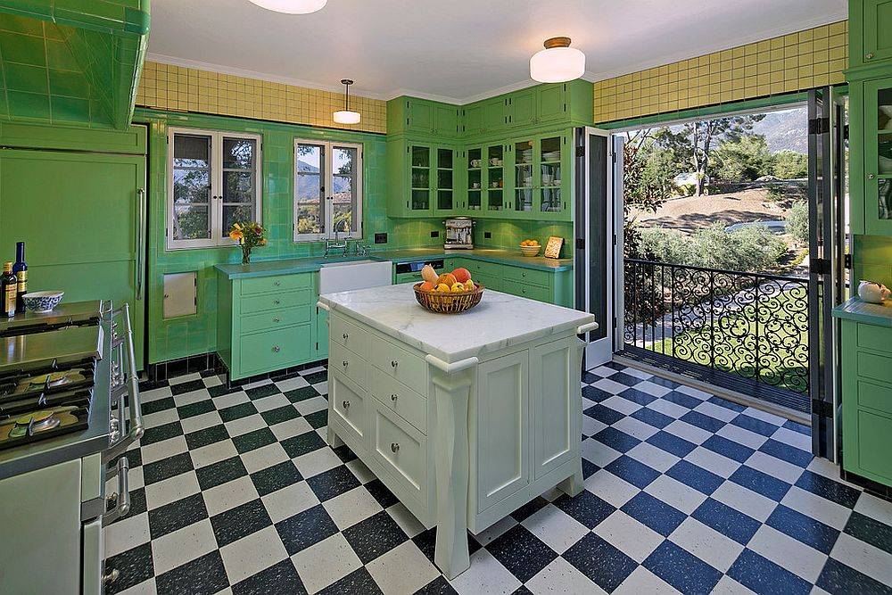 Mediterranean kitchen in green with black and white floor tiles