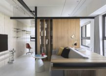 Mirrors-and-wood-help-create-a-cool-and-angled-bookshelf-in-the-living-room-217x155