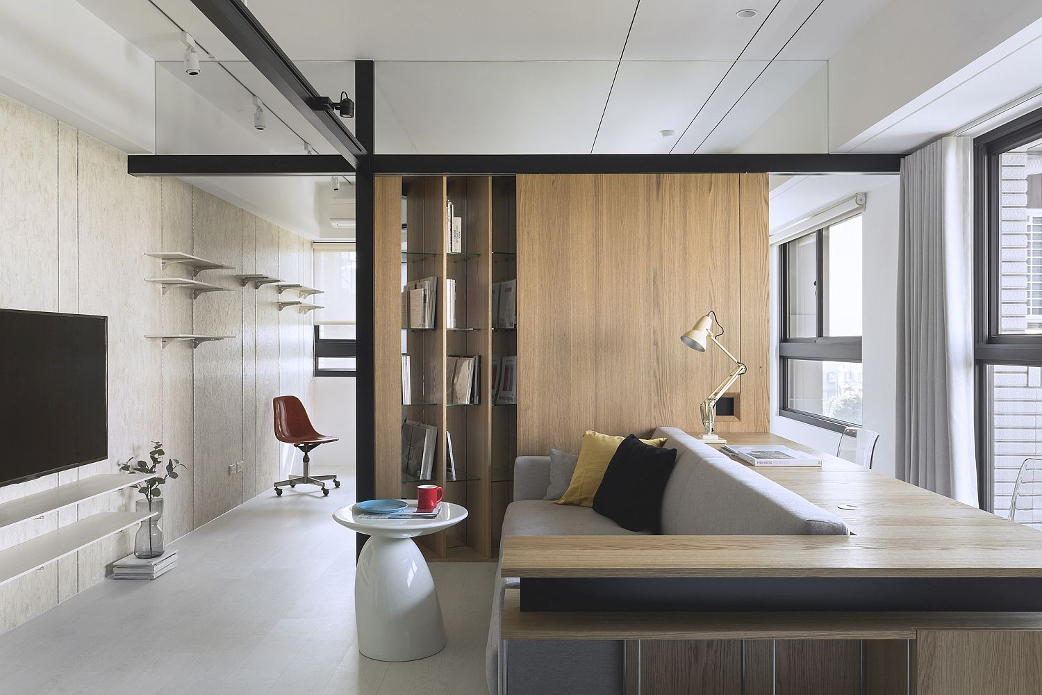 Mirrors and wood help create a cool and angled bookshelf in the living room