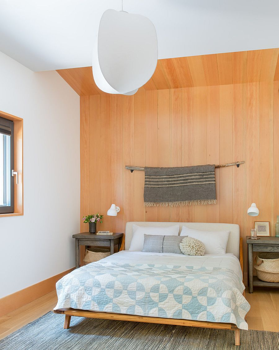 Modern rustic bedroom with a fabulous wooden accent wall in the backdrop