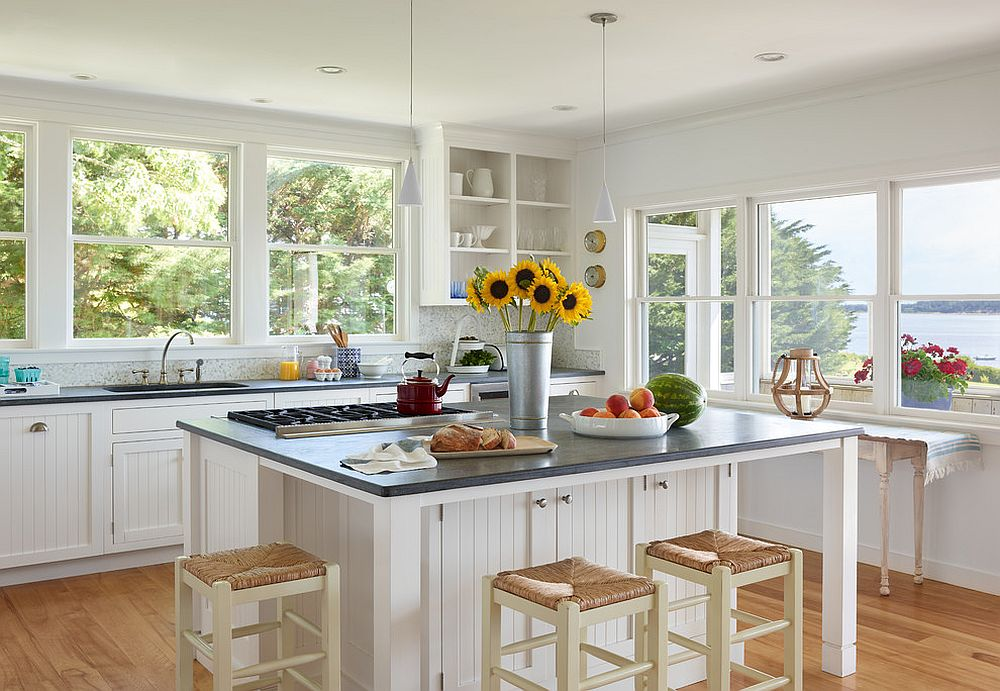 Multiple windows bring ample natural light into the stylish beach style kitchen