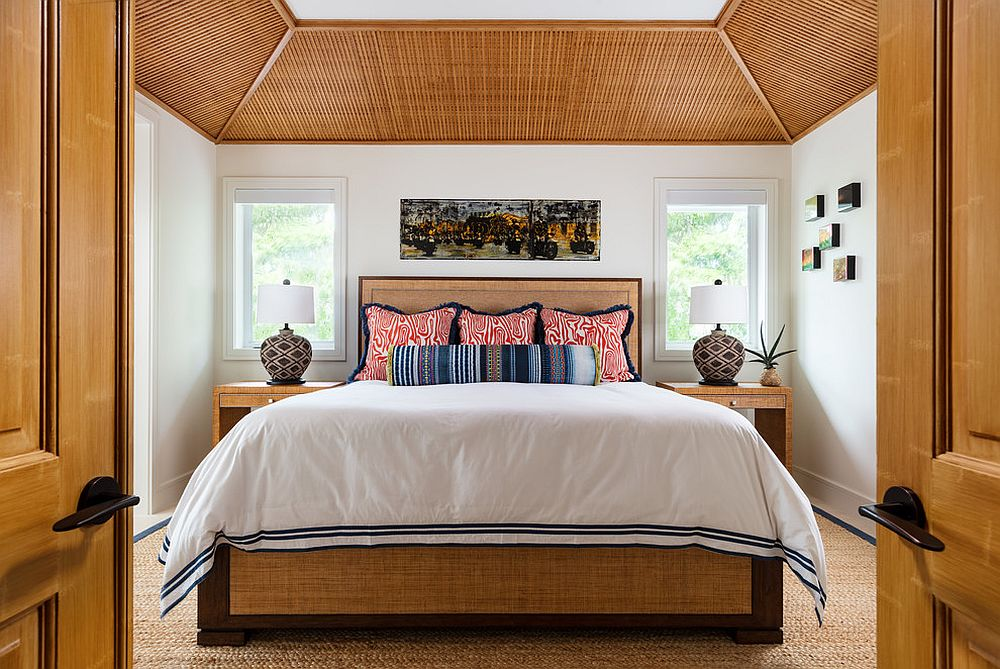Organic finsihes and fabric take this tropical bedroom in wood and white to a whole new level!