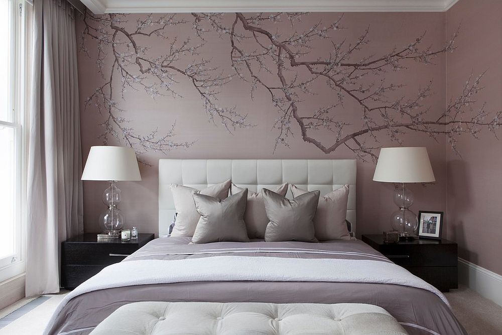 Painted wallpaper gives the bedroom a sense of uniqueness