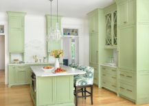 Pastel-green-gives-a-lovely-bright-aura-to-the-transitional-kitchen-217x155